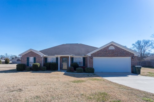 All brick ranch features 4 bedrooms, home office and almost 1/2 acre lot!